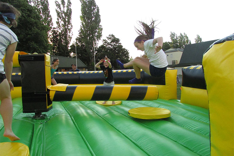Wipeout with kids jumping - Party Hire in Tauranga
